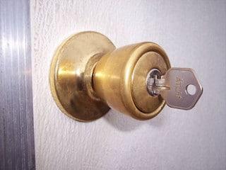 key in door lock, home security, tips for keeping your home safe, home security tips before vacation