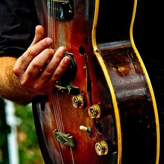 guitar, person playing guitar, sxsw austin, austin real estate agent, austin realtor