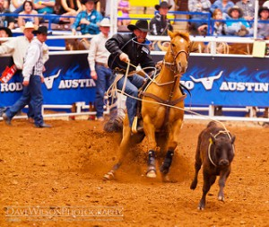 rodeo, cowboy, rider roping calf, best austin realtors, real estate agents in austin texas, real estate agents in austin tx, spring break