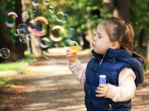 little girl blowing bubbles, moving with children, moving, austin real estate, sherri williams, abodo, austin apartments for rent, tips for moving, moving tips